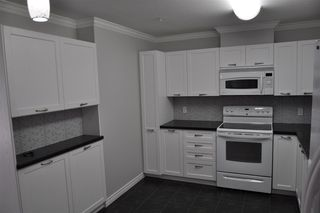 "Photo 4: 207 33728 KING Road in Abbotsford: Poplar Condo for sale in ""College Park"" : MLS®# R2255636"