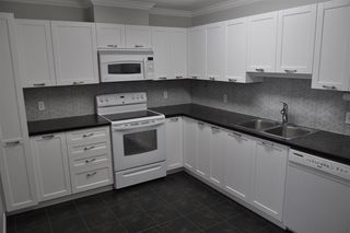 "Photo 3: 207 33728 KING Road in Abbotsford: Poplar Condo for sale in ""College Park"" : MLS®# R2255636"