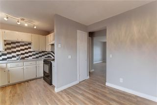 Photo 7: 104 2720 RUNDLESON Road NE in Calgary: Rundle Row/Townhouse for sale : MLS®# C4221687