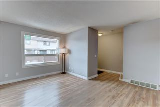 Photo 9: 104 2720 RUNDLESON Road NE in Calgary: Rundle Row/Townhouse for sale : MLS®# C4221687