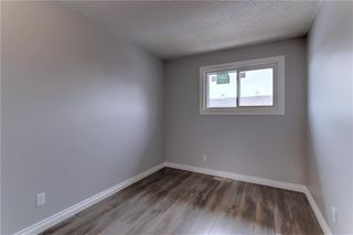 Photo 13: 104 2720 RUNDLESON Road NE in Calgary: Rundle Row/Townhouse for sale : MLS®# C4221687