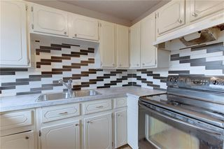 Photo 4: 104 2720 RUNDLESON Road NE in Calgary: Rundle Row/Townhouse for sale : MLS®# C4221687