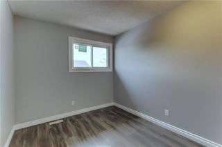 Photo 17: 104 2720 RUNDLESON Road NE in Calgary: Rundle Row/Townhouse for sale : MLS®# C4221687