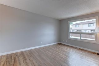 Photo 12: 104 2720 RUNDLESON Road NE in Calgary: Rundle Row/Townhouse for sale : MLS®# C4221687