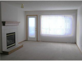 Photo 3: 106 QUIGLEY Close: Cochrane Residential Detached Single Family for sale : MLS®# C3464577