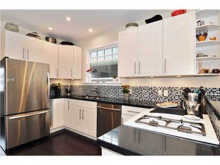 """Main Photo: 943 E 17TH Avenue in Vancouver: Fraser VE House for sale in """"CEDAR COTTAGE"""" (Vancouver East)"""