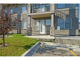 Photo 2: 109 22 PANATELLA Road NW in Calgary: Panorama Hills Condo for sale : MLS®# C3637232