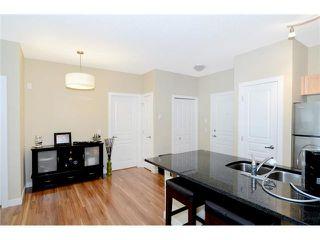Photo 7: 109 22 PANATELLA Road NW in Calgary: Panorama Hills Condo for sale : MLS®# C3637232