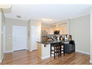 Photo 6: 109 22 PANATELLA Road NW in Calgary: Panorama Hills Condo for sale : MLS®# C3637232