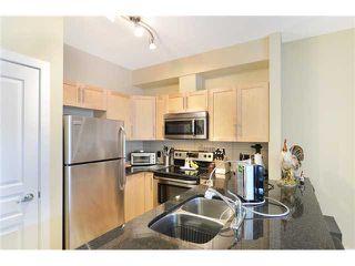 Photo 5: 109 22 PANATELLA Road NW in Calgary: Panorama Hills Condo for sale : MLS®# C3637232