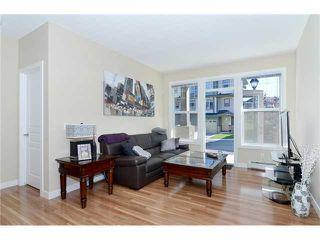 Photo 3: 109 22 PANATELLA Road NW in Calgary: Panorama Hills Condo for sale : MLS®# C3637232