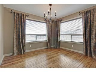 Photo 12: 135 PANORA Square NW in Calgary: Panorama Hills House for sale : MLS®# C4011248