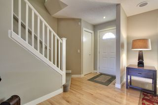 Photo 2: 39 West Springs Gate in Calgary: Duplex for sale : MLS®# C3601004