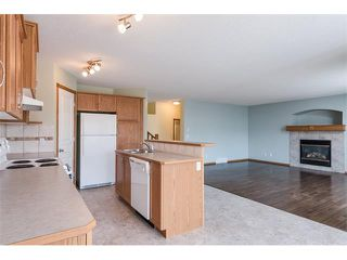 Photo 3: 223 CRYSTALRIDGE Place: Okotoks House for sale : MLS®# C4091900