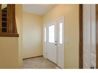 Photo 2: 223 CRYSTALRIDGE Place: Okotoks House for sale : MLS®# C4091900