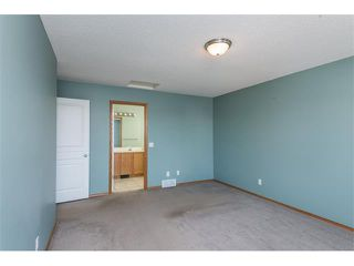 Photo 13: 223 CRYSTALRIDGE Place: Okotoks House for sale : MLS®# C4091900