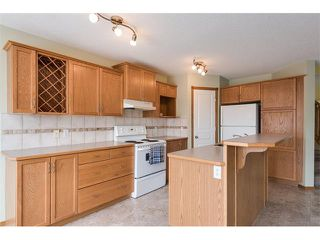 Photo 5: 223 CRYSTALRIDGE Place: Okotoks House for sale : MLS®# C4091900