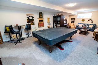 Photo 17: 2 1225 Wanyandi Road in Edmonton: Zone 22 House Half Duplex for sale : MLS®# E4115355