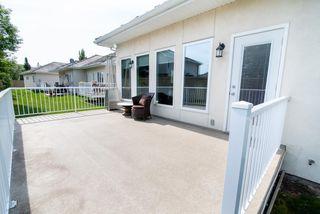 Photo 27: 2 1225 Wanyandi Road in Edmonton: Zone 22 House Half Duplex for sale : MLS®# E4115355
