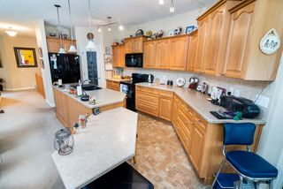 Photo 8: 2 1225 Wanyandi Road in Edmonton: Zone 22 House Half Duplex for sale : MLS®# E4115355