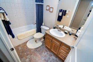 Photo 16: 2 1225 Wanyandi Road in Edmonton: Zone 22 House Half Duplex for sale : MLS®# E4115355