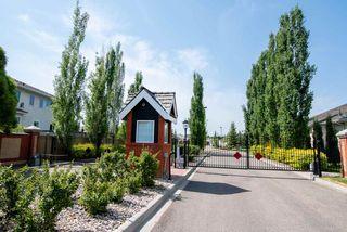Photo 29: 2 1225 Wanyandi Road in Edmonton: Zone 22 House Half Duplex for sale : MLS®# E4115355