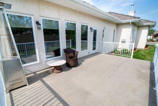 Photo 26: 2 1225 Wanyandi Road in Edmonton: Zone 22 House Half Duplex for sale : MLS®# E4115355