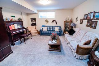 Photo 19: 2 1225 Wanyandi Road in Edmonton: Zone 22 House Half Duplex for sale : MLS®# E4115355