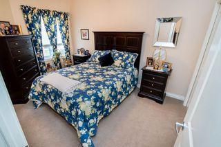 Photo 15: 2 1225 Wanyandi Road in Edmonton: Zone 22 House Half Duplex for sale : MLS®# E4115355
