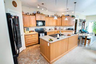 Photo 7: 2 1225 Wanyandi Road in Edmonton: Zone 22 House Half Duplex for sale : MLS®# E4115355