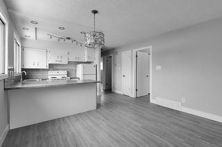 Photo 5: 403 MILLBOURNE Road E in Edmonton: Zone 29 House Half Duplex for sale : MLS®# E4193823