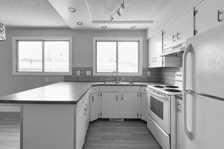 Photo 2: 403 MILLBOURNE Road E in Edmonton: Zone 29 House Half Duplex for sale : MLS®# E4193823