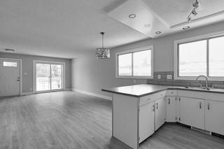 Photo 3: 403 MILLBOURNE Road E in Edmonton: Zone 29 House Half Duplex for sale : MLS®# E4193823