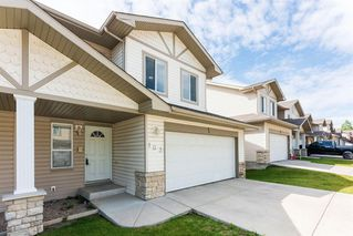 Photo 2: 103 Citadel Meadow Gardens NW in Calgary: Citadel Row/Townhouse for sale : MLS®# A1024145