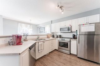 Photo 9: 103 Citadel Meadow Gardens NW in Calgary: Citadel Row/Townhouse for sale : MLS®# A1024145