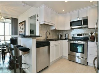 """Photo 5: 709 15111 RUSSELL Avenue: White Rock Condo for sale in """"PACIFIC TERRACE"""" (South Surrey White Rock)  : MLS®# F1405374"""