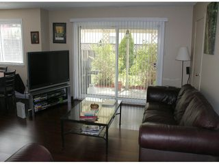 """Photo 2: 29 8555 KING GEORGE Boulevard in Surrey: Queen Mary Park Surrey Townhouse for sale in """"Bear Creek Village"""" : MLS®# F1409943"""
