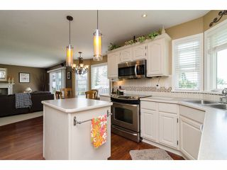 """Photo 9: 18066 64A Avenue in Surrey: Cloverdale BC House for sale in """"Orchard Ridge"""" (Cloverdale)  : MLS®# F1411692"""