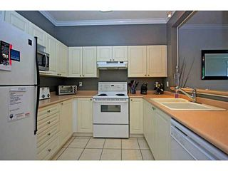 """Photo 7: 107 2340 HAWTHORNE Avenue in Port Coquitlam: Central Pt Coquitlam Condo for sale in """"BARRINGTON PLACE"""" : MLS®# V1097959"""