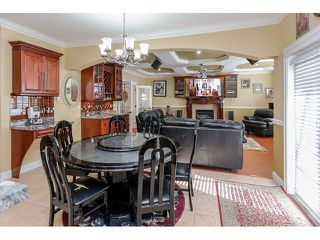 Photo 8: 3836 RUMBLE STREET - LISTED BY SUTTON CENTRE REALTY in Burnaby: Suncrest House for sale (Burnaby South)  : MLS®# R2002202