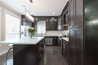 """Photo 10: 7683 210A Street in Langley: Willoughby Heights House for sale in """"Yorkson"""" : MLS®# R2079950"""