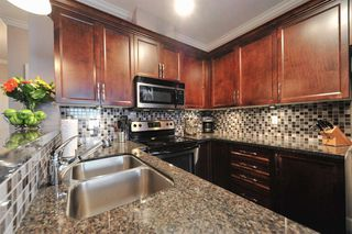"Photo 2: 100 15268 18 Avenue in Surrey: King George Corridor Condo for sale in ""Park Place"" (South Surrey White Rock)  : MLS®# R2243635"