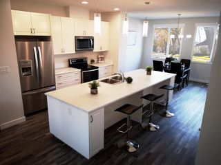 Photo 3: 11833 55 Street in Edmonton: Zone 06 House Half Duplex for sale : MLS®# E4159096