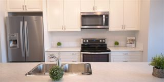Photo 2: 11833 55 Street in Edmonton: Zone 06 House Half Duplex for sale : MLS®# E4159096