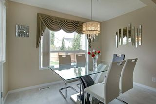 Photo 8: 202 Cougar Plateau Way SW in Calgary: Cougar Ridge Detached for sale : MLS®# A1029793