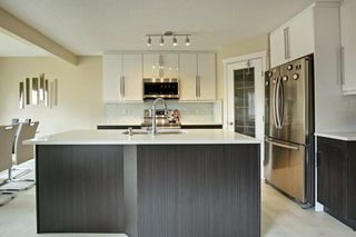 Photo 5: 202 Cougar Plateau Way SW in Calgary: Cougar Ridge Detached for sale : MLS®# A1029793