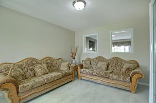 Photo 4: 202 Cougar Plateau Way SW in Calgary: Cougar Ridge Detached for sale : MLS®# A1029793