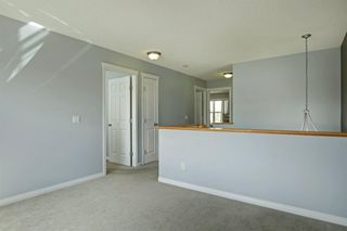 Photo 15: 202 Cougar Plateau Way SW in Calgary: Cougar Ridge Detached for sale : MLS®# A1029793