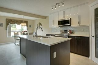 Photo 7: 202 Cougar Plateau Way SW in Calgary: Cougar Ridge Detached for sale : MLS®# A1029793