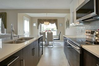 Photo 6: 202 Cougar Plateau Way SW in Calgary: Cougar Ridge Detached for sale : MLS®# A1029793